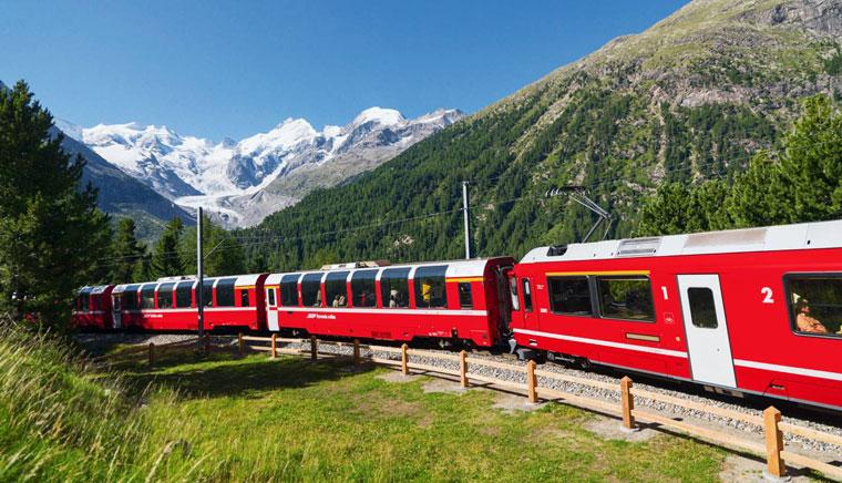 Bernina Express – часть Раетинской железной дороги нем. Rhätische Bahn сокращённо — RhB. - Bernina Express или красный швейцарский поезд